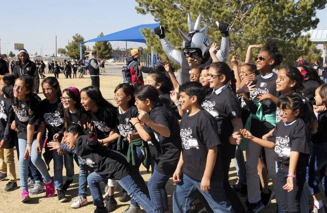 The Raiders, including Raider alumni Reggie Kinlaw and their mascot Raider Rusher, and the Nevada Dairy Council gave Sandy Searles Miller Academy a $10,000 Hometown Grant award in conjunction with the Fuel up to Play 60 campaign, which encourages kids to be active an hour a day, Wednesday, February 28, 2018.  MICK ACKERS