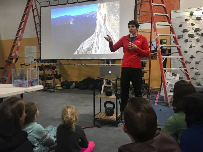 "Rock climber Alex Honnold gives a talk titled ""Alone on El Capitan"" about his experience climbing Yosemite National Park's El Capitan without the use of ropes, at The Refuge Climbing Center, Thursday, March 15, 2018."
