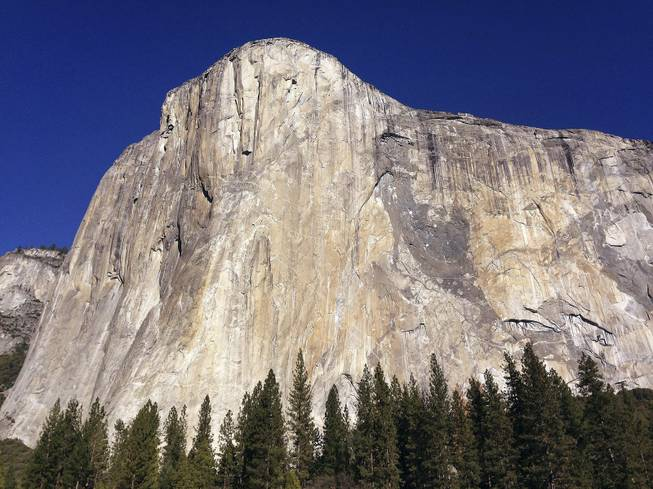 "FILE - This Jan. 14, 2015 file photo shows El Capitan in Yosemite National Park, Calif. An elite rock climber has become the first to climb alone to the top of the massive granite wall in Yosemite National Park without ropes or safety gear. National Geographic documented Alex Honnold's historic ascent of El Capitan on Saturday, June 3, 2017, saying the 31-year-old completed the ""free solo"" climb Saturday in nearly four hours. (AP Photo/Ben Margot, File)"