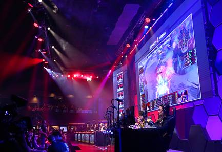 Teams eUnited, left, and Spacestation compete in a SMITE show match during the grand opening of the Esports Arena Las Vegas at the Luxor Thursday, March 22, 2017.