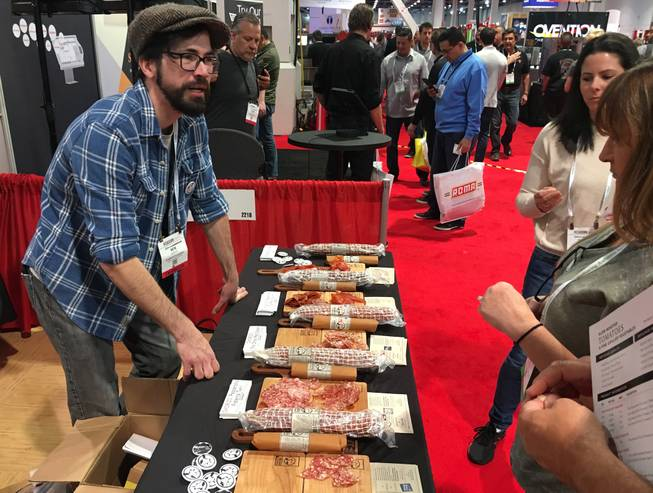 Ben Parker from Charlito's Cocina in New York shares some product at the International Pizza Expo at the Las Vegas Convention Center on March 21.