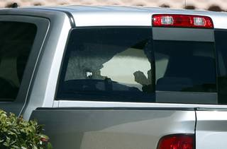 Damage to a pickup truck rear window is shown after a shooting at a Terrible Herbst at Sunset Road and Annie Oakley Drive in Henderson Friday, March 30, 2018.