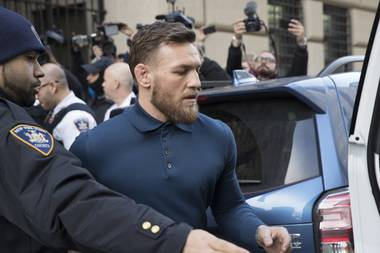 Ultimate fighting star Conor McGregor heads to a vehicle to leave Brooklyn Criminal Court, Friday, April 6, 2018 in New York.