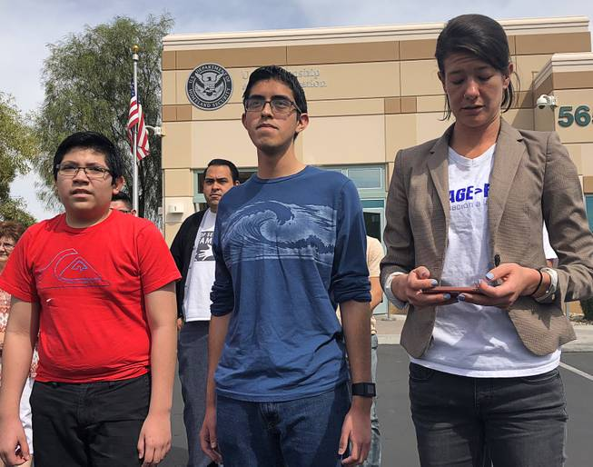 Ricardo Avalar-Gomez and Eric Avalar-Gomez speak to the media on Thursday, April 5, 2018, about the deportation of their mother, Cecilia Gomez. Bliss Requa-Trautz, director of the Las Vegas Worker Center, appears at right. Gomez was detained at a U.S. Citizenship and Immigration Services office during an appointment to receive permanent residency.