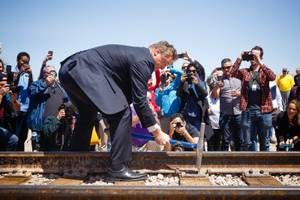 U.S. Senator Dean Heller (R-NV) drives a final spike into a railroad track during an event to celebrate reconnecting the Nevada Southern Railway from Boulder City to Henderson, Friday, April 13, 2018.