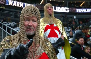 Vegas Golden Knights fans Niels Hartvig-Nielsen, left, and David Pelckai are dressed as knights during an NHL hockey first-round play-off series against the Los Angeles Kings at T-Mobile Arena Friday, April 13, 2018.