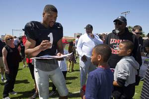 Quarterback Armani Rogers signs autographs during the UNLV Rebels Spring Showcase at UNLV Saturday, April 14, 2018.
