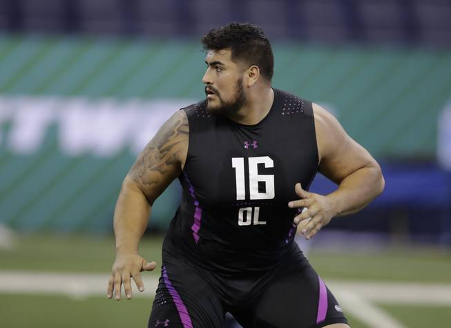 UTEP offensive lineman Will Hernandez runs a drill during the NFL football scouting combine, Friday, March 2, 2018, in Indianapolis.