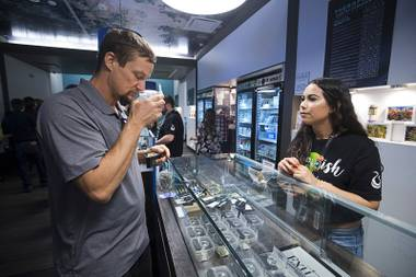 Alyssa Justino helps Michael Brousseau as he shops at Exhale Nevada dispensary during a dispensary bus tour sponsored by the Las Vegas Medical Marijuana Association Friday, April 20, 2018.