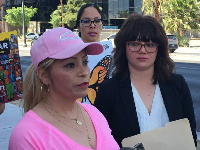 Cecilia Gomez, left, stands with her attorney Laura Barrera at a news conference in front of a U.S. Immigration Customs and Enforcement office in Las Vegas on Thursday, April 26, 2018.