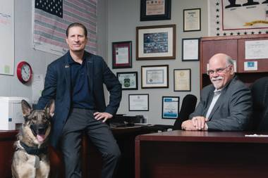 22 Warriors Foundation Chairman Bill Emmel, left, his service dog Ranger and Vice Chairman Dave Austin in their office. 22 Warriors Foundation is a veteran-founded, -operated and -governed nonprofit organization dedicated to eliminating veteran suicides.