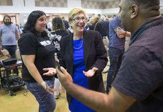 Chris Giunchigliani, center, Clark County commissioner and Democratic candidate for Nevada governor, meets with attendees following a gubernatorial candidates accountability session with Nevadans for the Common Good at Saint Elizabeth Ann Seton Church in Summerlin Tuesday, May 8, 2018. STEVE MARCUS