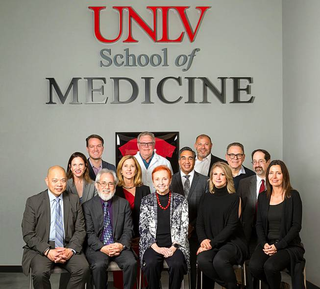 UNLV School of Medicine Dean Barbara Atkinson, center, is shown with supporters March 21, 2018, at the medical school.