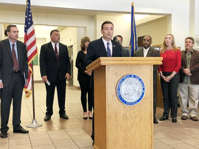 Nevada Attorney General Adam Laxalt announces a lawsuit against Purdue Pharma during a news conference at the Grant Sawyer Building in Las Vegas on May 15, 2018. Laxalt's office is accusing the drug manufacturer of contributing to the state's opioid crisis by exaggerating OxyContin's role in pain relief and purposely understating risk of addiction/