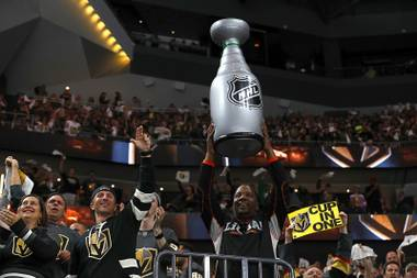 Vegas Golden Knights fans celebrate a score against the Winnipeg Jets during the second period of Game 3 in an NHL Western Conference Finals at T-Mobile Arena, Wednesday, May 16, 2018.