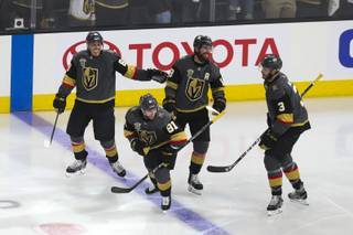 The Vegas Golden Knights celebrate after scoring during the first period of Game 3 in an NHL Western Conference Finals at T-Mobile Arena, Wednesday, May 16, 2018. WADE VANDERVORT