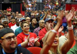 Members of the Culinary Workers Union, Local 226, applaud during a presentation before voting on whether to authorize a strike Tuesday, May 22, 2018, in Las Vegas. A potential strike would affect 34 casino-hotels.