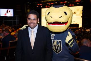 Chaparral High School basketball player Nick Doland poses for a photo with Golden Knights mascot Chance during the Las Vegas Sun Standout Awards at South Point, Wednesday, May 23, 2018.