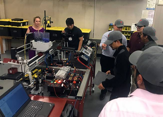Students and instructors are shown in the advanced manufacturing lab at the Southeast Career and Technical Academy, Wednesday, May 23, 2018.