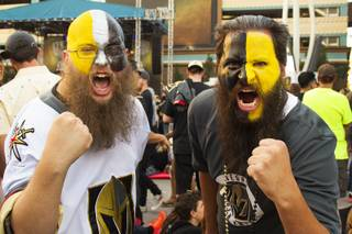 Two Vegas Golden Knights fans pose for a photo during Game 1 of the VGK versus the Washington Capitals NHL Stanley Cup Finals at Toshiba Plaza outside T-Mobile Arena, Monday, May 28, 2018.