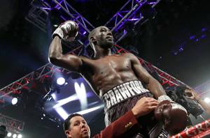 Terence Crawford celebrates after defeating Jeff Horn, of Australia, in a welterweight title boxing match, Saturday, June 9, 2018, in Las Vegas.