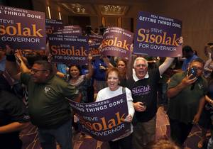 Veronica and Ron Wasak show their support for Democratic gubernatorial candidate Steve Sisolak during an election watch party at the Aria convention center Tuesday, June 12, 2018.