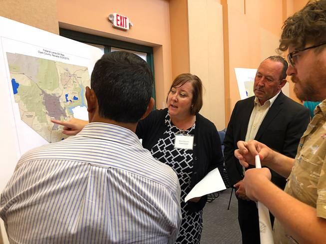 Marci Henson, director of the Clark County Department of Air Quality, points to a map designating areas of potential future development.