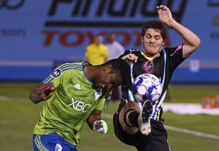 Seattle Sounders FC 2 defender Rodrigue Ele (92) collides with Las Vegas Lights FC midfielder Zach Mathers during their game Saturday, June 16, 2018, at Cashman Field. The Lights won 4-1.
