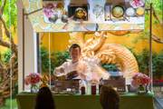 Chef Alan Ji demonstrates how to cook a signature three cup sea bass for guests during a Master Class at Wing Lei, Wynn, Friday June 15, 2018.