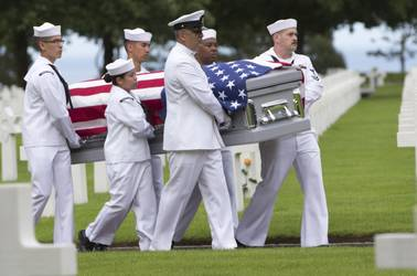 U.S. Navy personnel carry the casket of WWII U.S. Navy sailor Julius Pieper during a reburial service at the Normandy American Cemetery, Colleville-sur-Mer, France, Tuesday, June 19, 2018. Seventy four years to the day after their ship hit a mine off the coast of Normandy and sunk, Julius Pieper was finally reunited with his twin brother Ludwig.