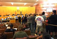 Residents line the aisle at a Clark County Commission meeting to weigh in on a public lands resolution that passed unanimously on Tuesday, June 19, 2018. The resolution asks Nevada's congressional delegation to draft bills that would make environmental designations, among many other changes.