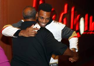 Troy Brown Jr. hugs his father after being selected by the Washington Wizards during a NBA Draft party at the Red Rock Lanes in Summerlin Thursday, June 21, 2018. The Wizards selected Brown, a Centennial High graduate, with the No. 15 pick in the NBA draft.