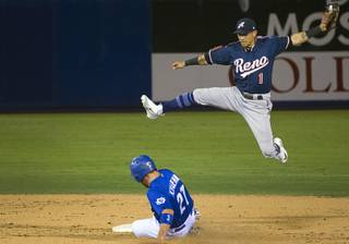 Las Vegas 51s' Patrick Kivlehan steals second base under  Reno Aces' Ildemaro Vargas at Cashman Field Thursday, June 21, 2018. The 51s beat the Aces 5-3.