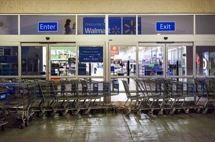Shopping carts block an entrance to the Walmart Supercenter at 6464 N. Decatur Blvd. early Thursday, June 21, 2018. The store changed its hours in February from 24 hours a day to 6 a.m. to midnight.