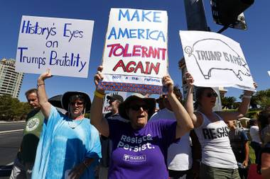 Laurie Lytel, center, and other protesters picket outside the Suncoast before President Donald Trump's address to the Nevada State GOP Convention in Summerlin on Saturday, June 23, 2018.