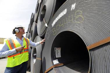 CEO Joel Johnson checks the details on a roll of steel at the Borusan Mannesmann Pipe manufacturing facility Tuesday, June 5, 2018, in Baytown, Texas. Borusan is seeking a waiver from the steel tariff to import 135,000 metric tons of steel piping annually over the next two years.
