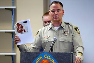 Metro Police Capt. Todd Raybuck holds up a map during a news conference on illegal fireworks at Clark County Fire Station 22 Thursday, July 5, 2018. The map shows the location of illegal fireworks complaints over the July 4th holiday.