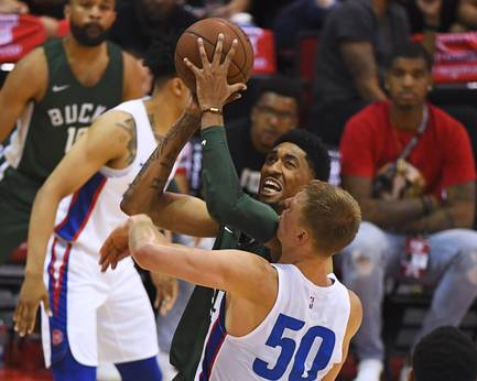 Milwaukee Bucks center Christian Wood is fouled by a Detroit Pistons player during their NBA Summer League game Friday, July 6, 2018, at the Thomas & Mack Center.