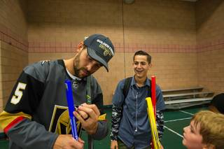 Deryk Engelland of the Vegas Golden Knights signs a hockey stick for 16 year-old Kaden Reynolds during a VGKs youth hockey outreach program at the Walnut Recreation Center, Tuesday July 10, 2018.