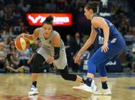 Las Vegas Aces guard Kayla McBride drives against Minnesota Lynx forward Cecilia Zandalasini during a game Friday, July 13, 2018, in Minneapolis.