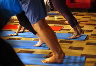 People participate in a trauma recovery yoga group at the 705 Art Incubator in downtown Las Vegas Wednesday, July 18, 2018.