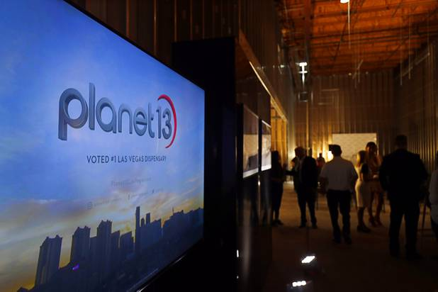 A video plays during a news conference for the Planet 13 Superstore dispensary, a cannabis entertainment complex, under construction on Desert Inn Road near The Strip Thursday, July 19, 2018. Phase 1, expected to be complete in November 2018, will include an interactive entertainment space and more than 16,500 sq. ft. of retail space.