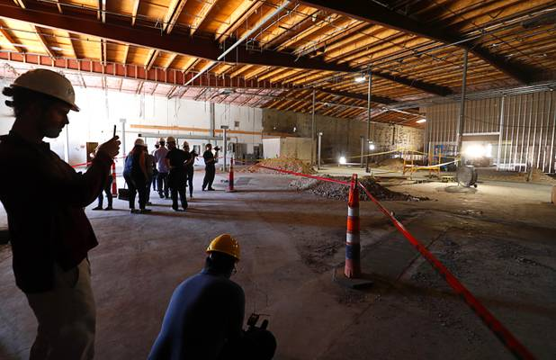 Journalists and guests get a view of what will become the dispensary floor during a news conference for the Planet 13 Superstore dispensary, a cannabis entertainment complex, under construction on Desert Inn Road near The Strip Thursday, July 19, 2018. Phase 1, expected to be complete in November 2018, will include an interactive entertainment space and more than 16,500 sq. ft. of retail space.
