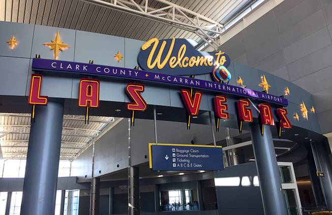 A sign welcomes travelers at McCarran International Airport.