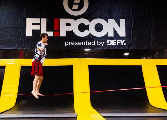 Influencer Jordan Bell (instagram @jaybells) from North Carolina tries out the tight rope during the second annual FlipCon event sponsored by Circus Trix at their park Gravady in Las Vegas, Monday, 23, 2018. FlipCon invites influencers from all over the U.S. to participate in SuperTramp activities to produce content for their fan base and to network with fellow influencers.