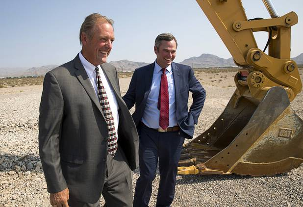 North Las Vegas Mayor John Lee and North Las Vegas City Manager Ryann Juden smile at the conclusion of a water pipeline groundbreaking ceremony near Speedway Boulevard and Centennial Parkway in North Las Vegas Tuesday, July 31, 2018. The pipeline, expected to be completed in late 2020, will jumpstart development in the Apex Industrial Park, officials said.
