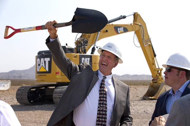 North Las Vegas Mayor John Lee holds up a shovel during a water pipeline groundbreaking ceremony near Speedway Boulevard and Centennial Parkway in North Las Vegas Tuesday, July 31, 2018. At right is pipeline partner Weston Adams. The pipeline, expected to be completed in late 2020, will jumpstart development in the Apex Industrial Park, officials said.