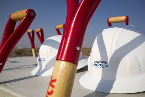 Hardhats and shovels are positioned on a table before a water pipeline groundbreaking ceremony near Speedway Boulevard and Centennial Parkway in North Las Vegas Tuesday, July 31, 2018. The pipeline, expected to be completed in late 2020, will jumpstart development in the Apex Industrial Park, officials said.