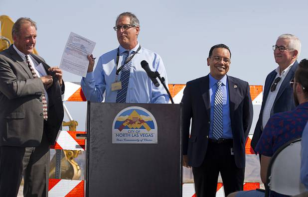Dale Daffern, director of North Las Vegas public works, holds up the construction permit during a water pipeline groundbreaking ceremony near Speedway Boulevard and Centennial Parkway in North Las Vegas Tuesday, July 31, 2018. Also pictured, from left, are North Las Vegas Mayor John Lee, Alfredo Melesio Jr., director of land development and community services, and Randall DeVaul, director of utilities. The pipeline, expected to be completed in late 2020, will jumpstart development in the Apex Industrial Park, officials said.