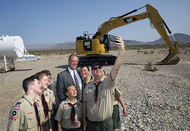 Las Vegas Mayor John Lee poses for a photo with Scoutmaster Matt Motl and Boy Scouts with Troop 306 during a water pipeline groundbreaking ceremony near Speedway Boulevard and Centennial Parkway in North Las Vegas Tuesday, July 31, 2018. The pipeline, expected to be completed in late 2020, will jumpstart development in the Apex Industrial Park, officials said.